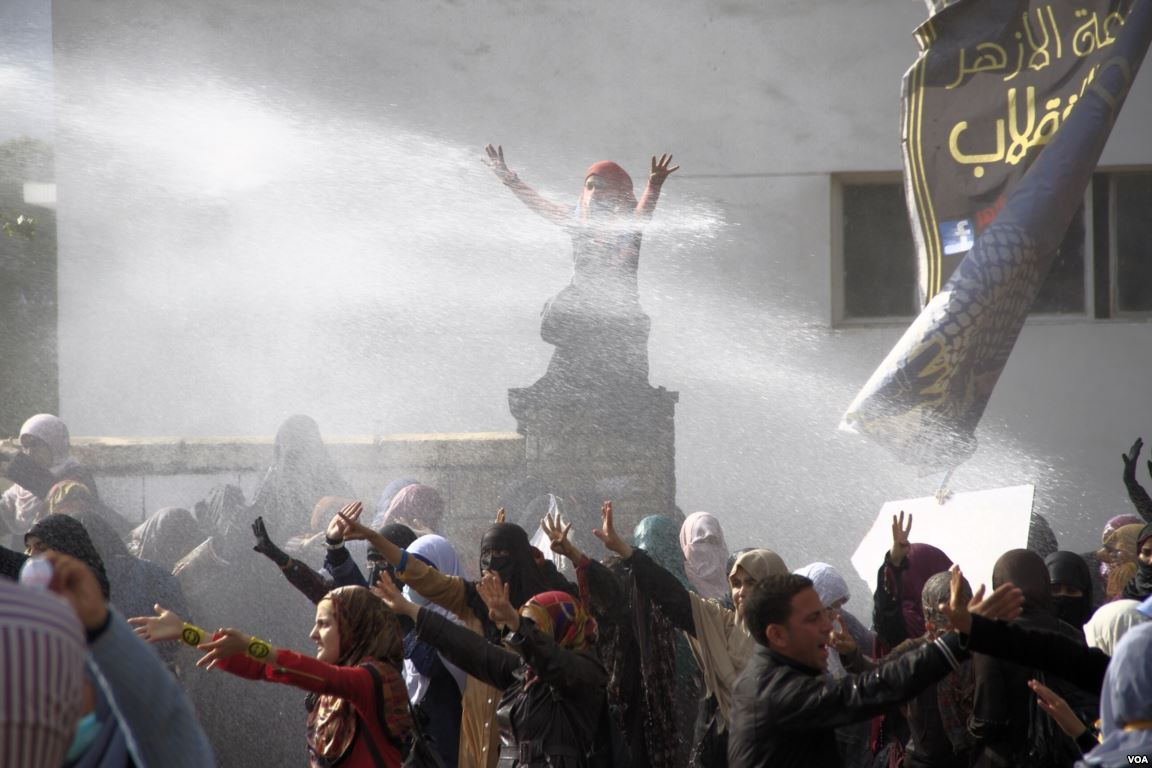 content/images/img-19-20/programme/cover/Water_cannon_fired_on_female_Islamist_students_-_protest_at_Al-Azhar_University_Cairo_11-Dec-2013.jpg